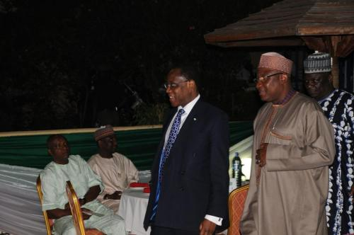 CGC-Abdullahi-Dikko-walks-the-HMF-Olusegun-Aganga-into-the-venue-of-the-Dinner