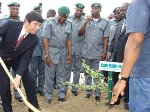 The-WCO-Sec-Gen-Mr-Kunio-Mikuriya-plants-a-tree-to-commemorate-his-working-visit-to-Nigeria-at-the-Command-Staff-College-Gwagwalada-Abuja